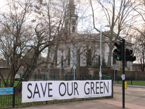 Banner 'Save our green' attached to fence at Deptford Church Street/Coffey Street
